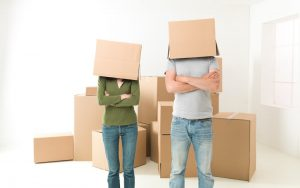 new homeowners with moving boxes on their heads