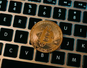 bitcoin coin on laptop