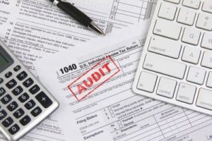 Concept image for filing federal income taxes online and being audited.