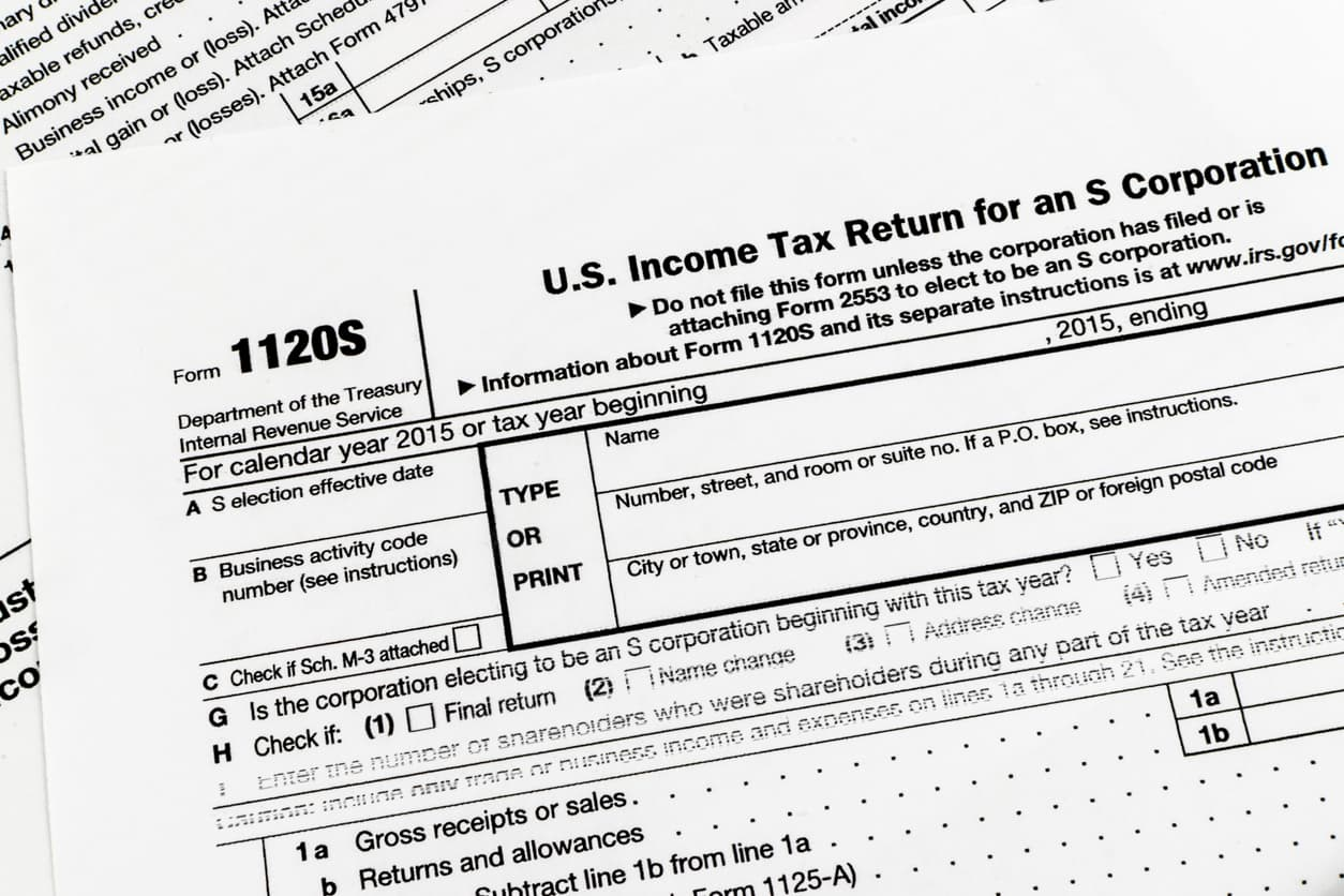 form 1120-S on top of other blank tax forms