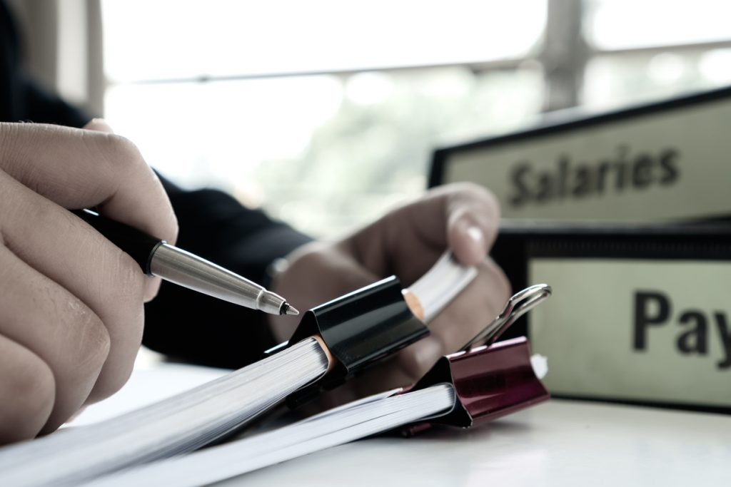 Salaries and pay for employees paperwork, employee benefit IRS forms concept