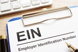 Employer Identification Number (EIN) on a clipboard.