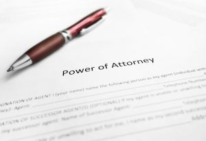 Close-up shot of a Power of Attorney legal document with pen enacted with Form 2848.