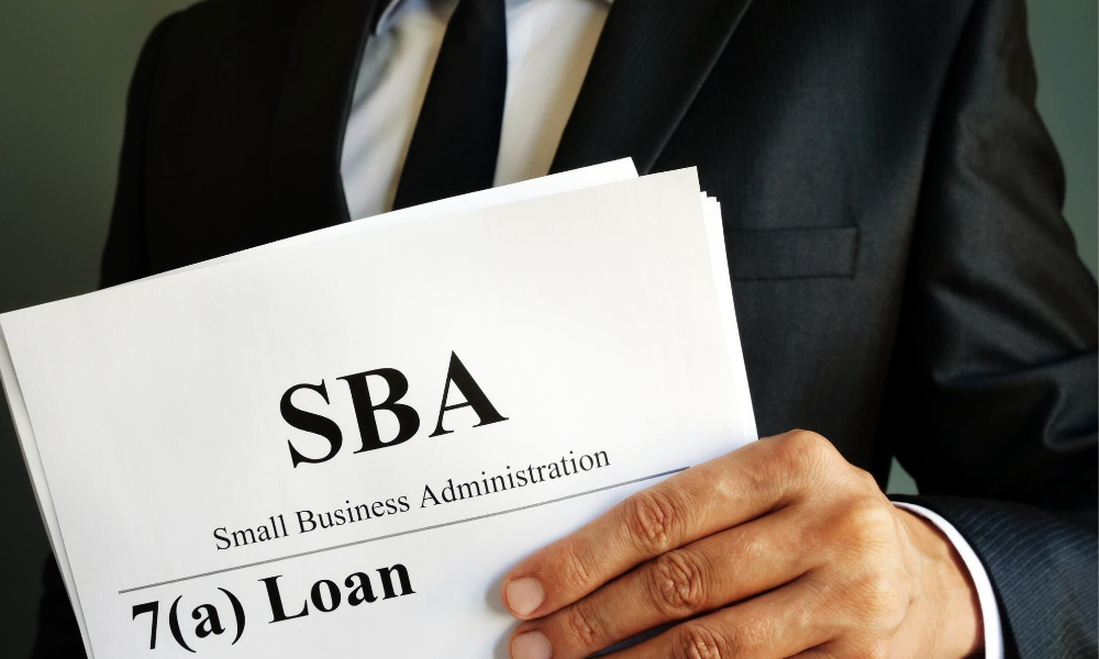 small business administration representative giving loan.