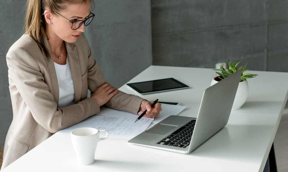 Business woman filling out IRS form 8865
