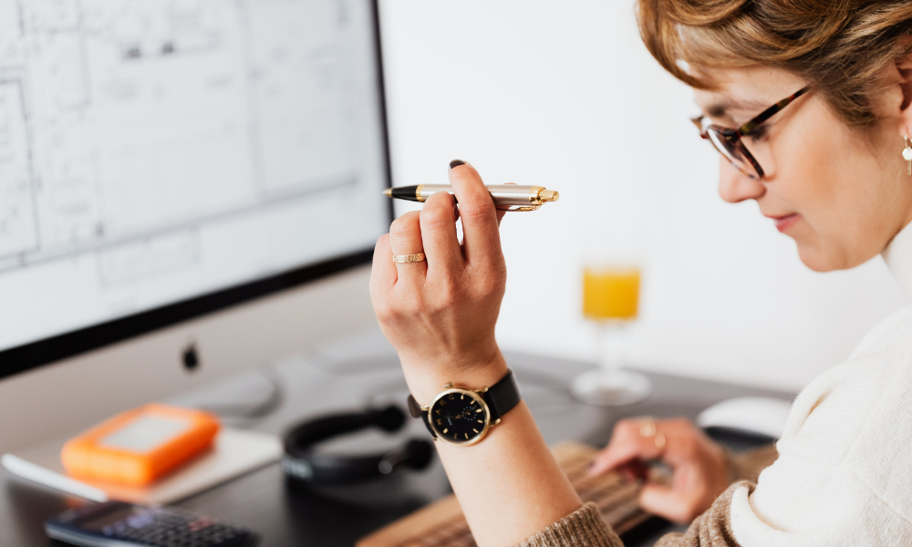 woman deciding whether to use accrual accounting or another strategy for her business