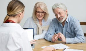 couple completing estate planning checklist for their will