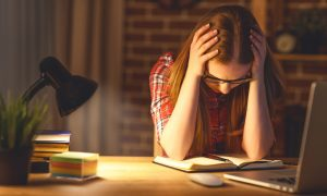 woman who needs to know how to stop student loan wage garnishment
