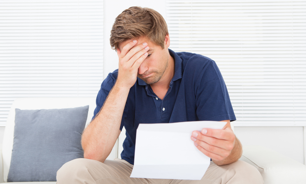man in debt applying for irs partial payment installment agreement plan