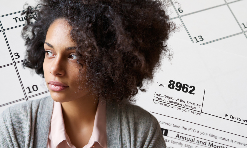 woman filing form 8962 and applying for the advance premium tax credit