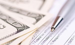 A cash payment sits atop IRS Form 8300