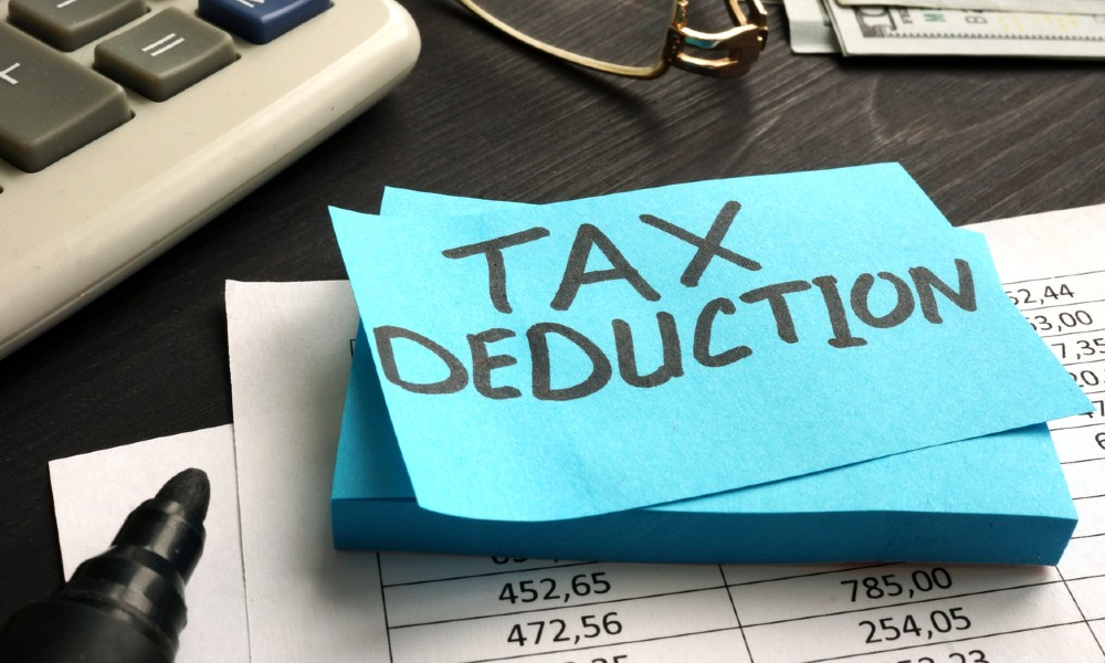 IRS section 179 tax deduction written on blue paper with black ink.