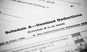 Closeup of a tax deduction form, where a taxpayer would file for a standard mileage rate deduction.