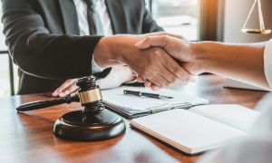 A taxpayer shakes hands with a tax lawyer after getting a federal tax lien released.