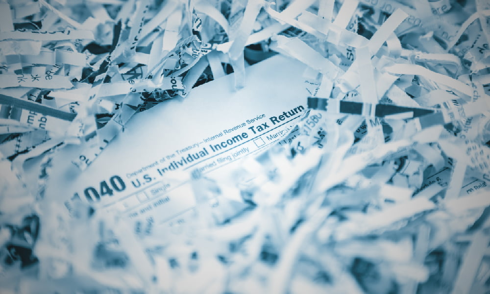 substitute for return 1040 tax form buried in shredded paper