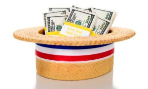 A hat holds many cash political contributions, illustrating our guide to whether political contributions are tax deductible.