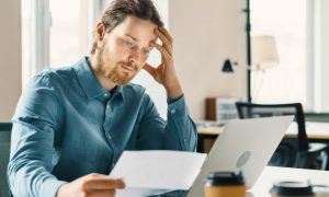 A man frustrated after he got his tax return rejected